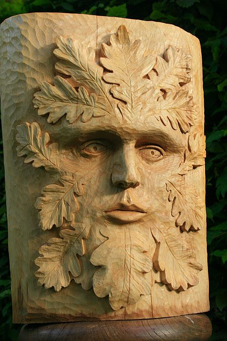 green man on wood