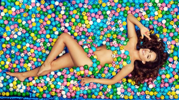 kelly-brook-lying-on-a-bed-of-lotto-balls