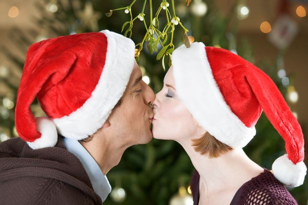 A-couple-kissing-beneath-the-mistletoe